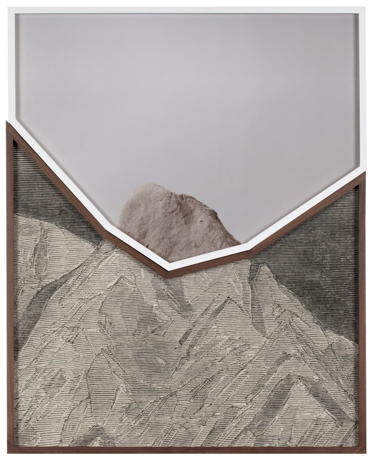 Two photographs in jagged-edge frames that fit together to form a rectangle. The top photograph is of a rock, and the bottom is of an etching of a mountain. The two come together to form a whole image of a mountain.