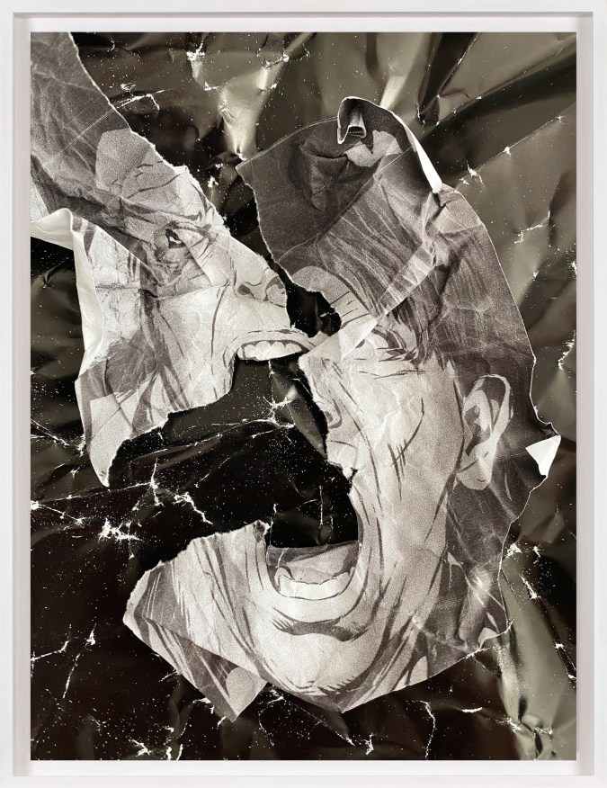 A framed collage of crumpled pages from comic books, with a torn screaming face at the center.