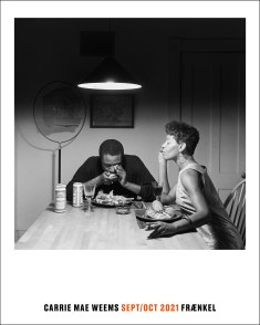 Poster of a black and white photograph of an African American couple at a kitchen table, a man seated and reading the paper, a woman standing behind with her hands on his shoulders.