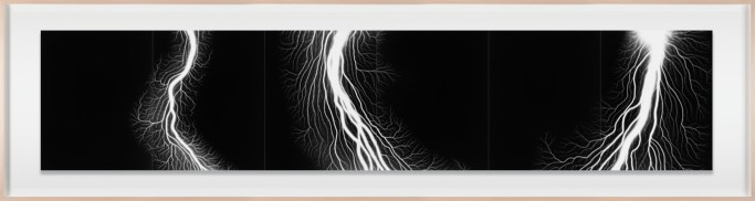 A long, framed photograph of three white lightning fields on a dark black background.