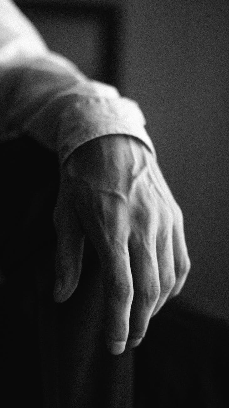 left hand of a man in grayscale photography