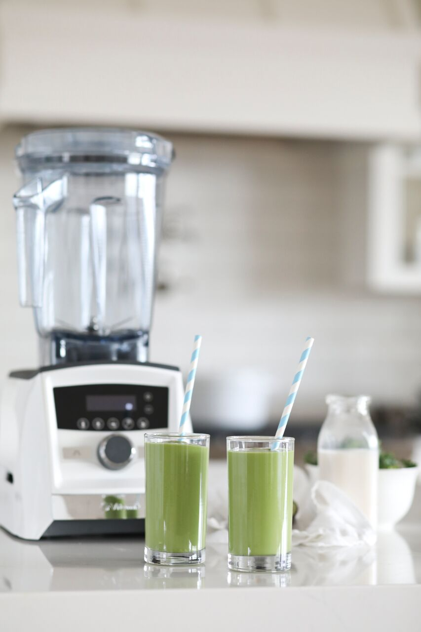 Dietitian's Green Smoothie that the kids love made in a white Vitamix Ascent Series machine.