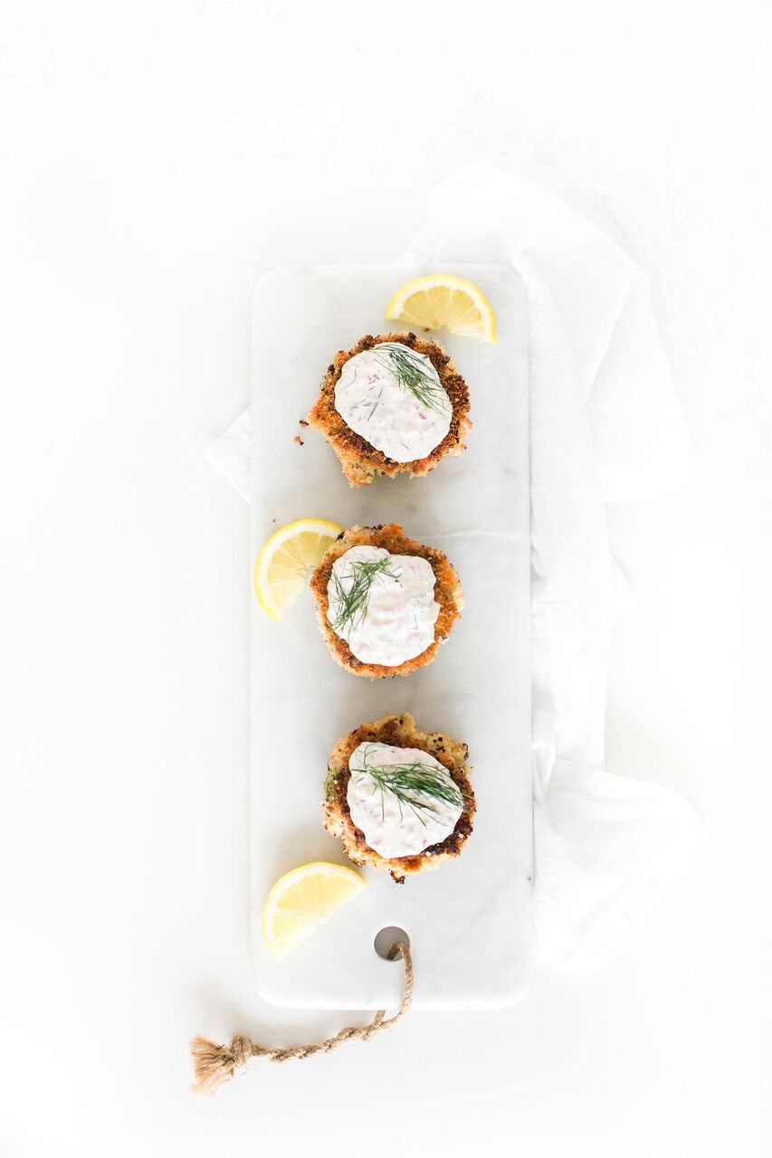 The BEST salmon cakes you will ever eat, made with smoked and fresh salmon and topped with an addictive homemade dill tartar sauce by Fraiche Nutrition.