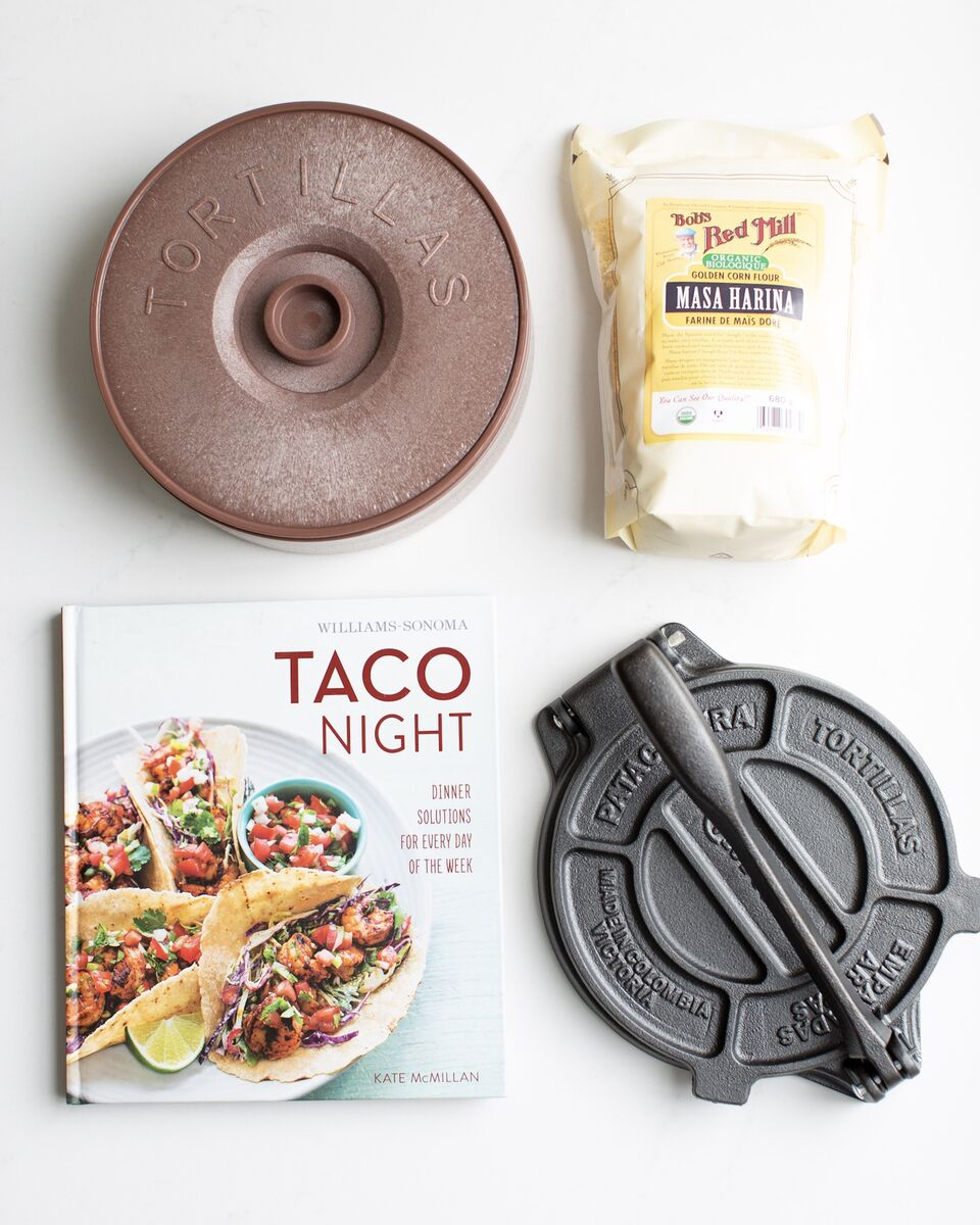 All the tools to make home-made corn tortillas! Tortilla warmer, masa harina, a tortilla press and an epic taco cookbook by Williams Sonoma!