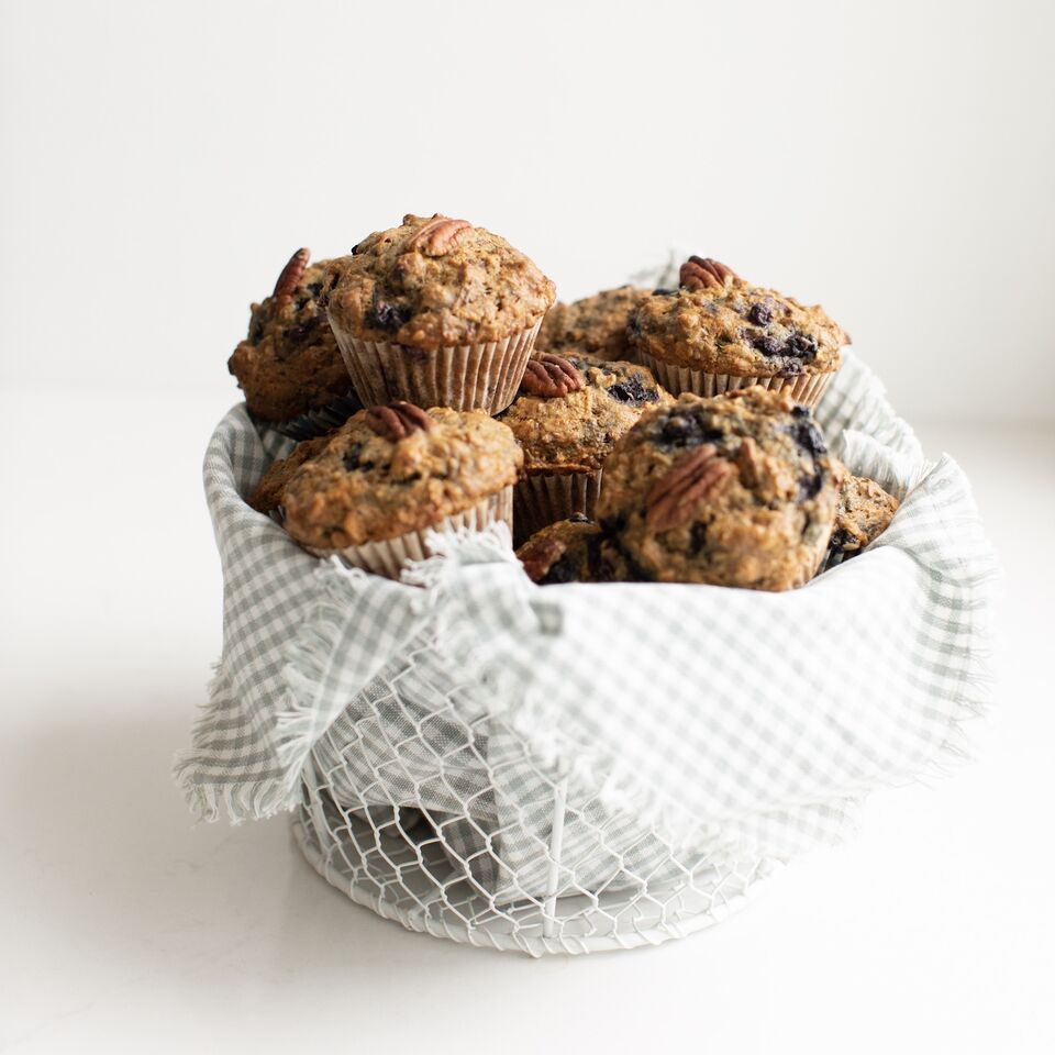 """A basket full of Sneaky Mommy Muffins: Designed by a Registered Dietitian, these """"Fruit and veggie"""" muffins filled with healthy vegetables, fibre, lightly sweetened with a vegan option! These freeze beautifully."""