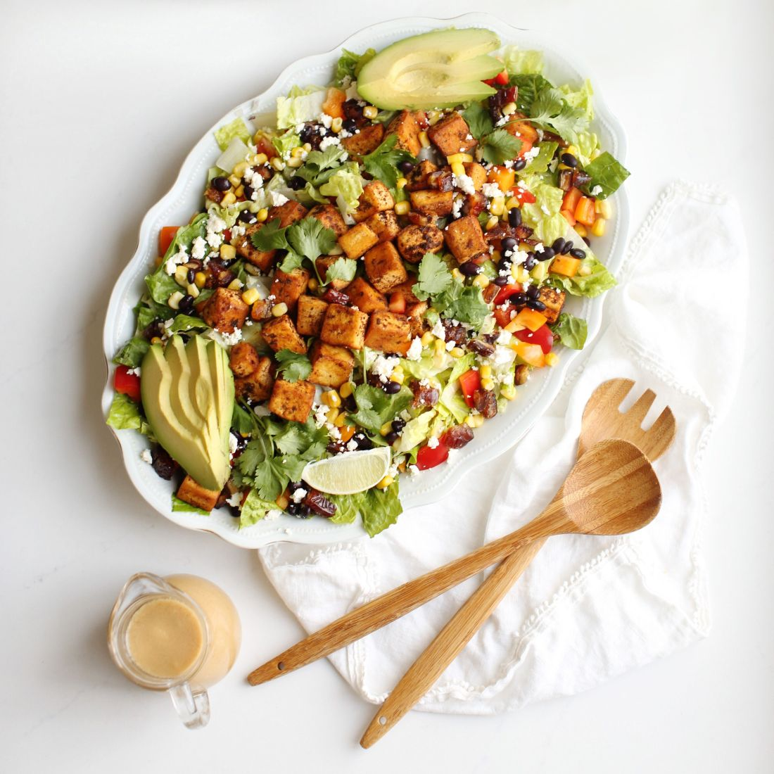Cowgirl Salad - a Santa Fe inspired salad topped with either cajun tofu or chicken and filled with healthy ingredients topped with a perfect peanut lime salad dressing