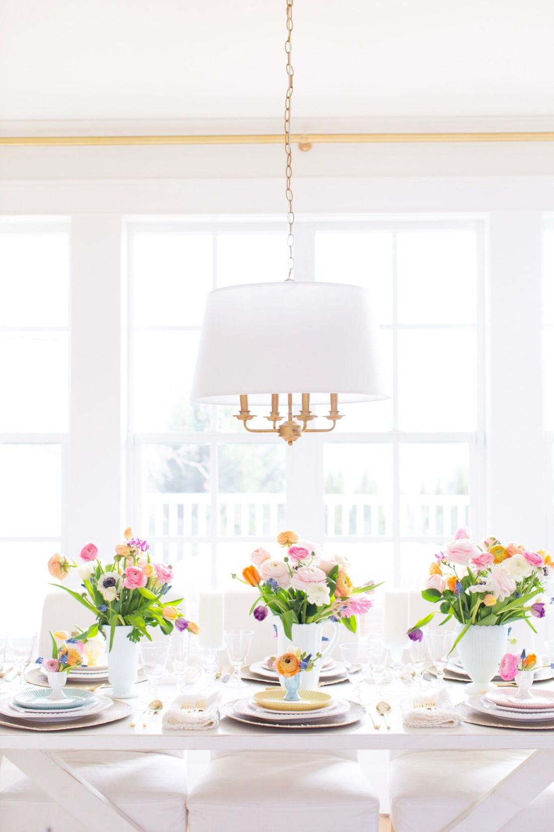 Easter Fraiche Table Dinner with pastel florals, white dinner ware and gold flatware