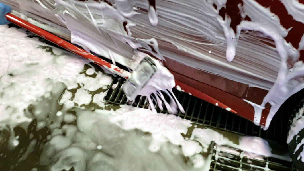 Using boar's hair foam brush to wash bottom half of car last
