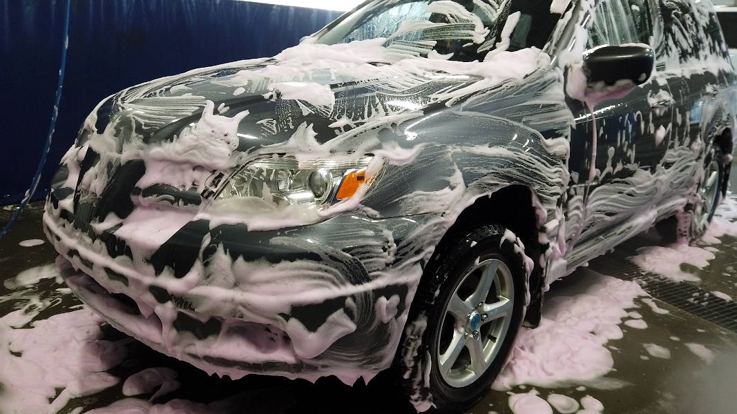 Foam brush cleaning stage completed at self-serve car wash - Mitsubishi Outlander
