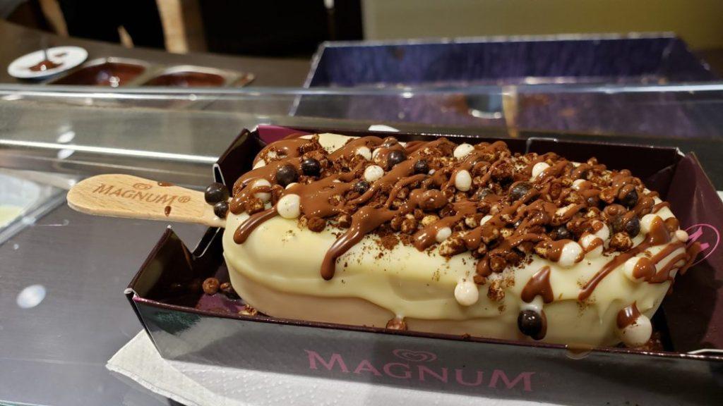 Magnum ice cream bar with white coating and Callebaut crisps