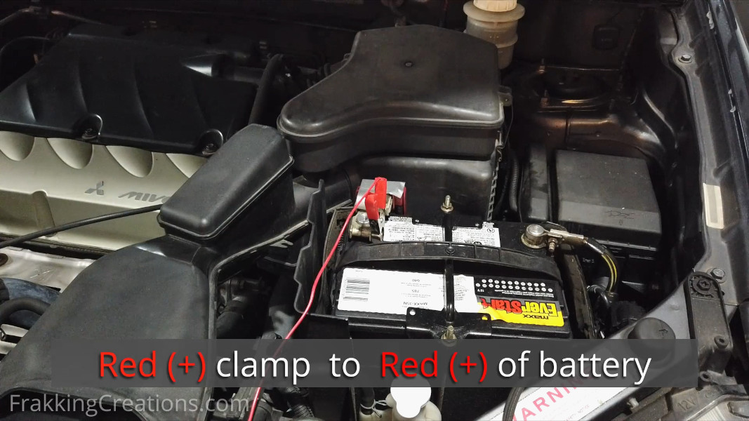 Connecting Red Positive clamp of car battery charger to positive terminal of battery
