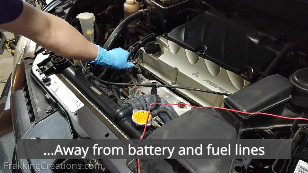 Connecting Black Negative clamp of car battery charger to solid metal part of engine block (Away from battery and fuel lines)