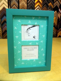 Teal frame with dragonfly fabric.