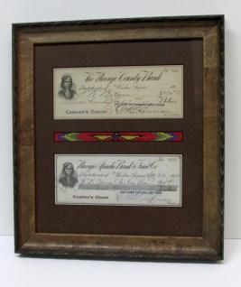Framed vintage western USA currency and beaded bracelet