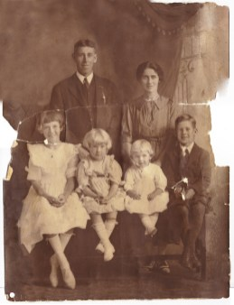 Dickson Family before digital restoration, photo was cracked in half