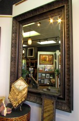 View of our gallery reflected in a gorgeous steampunk - cowboy - victorian mirror.
