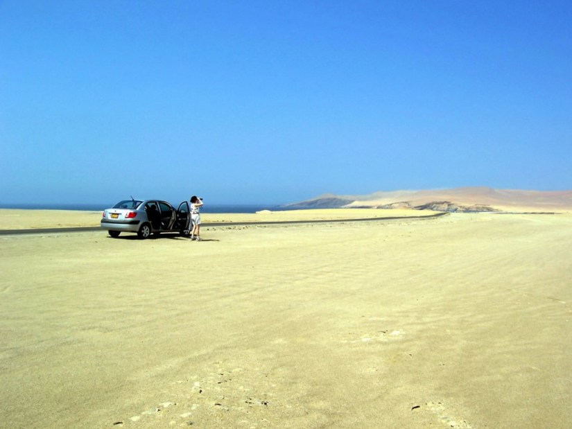 Jean in the desert at Paracas National Reserve on the Paracas Peninsula, Ica, Peru.