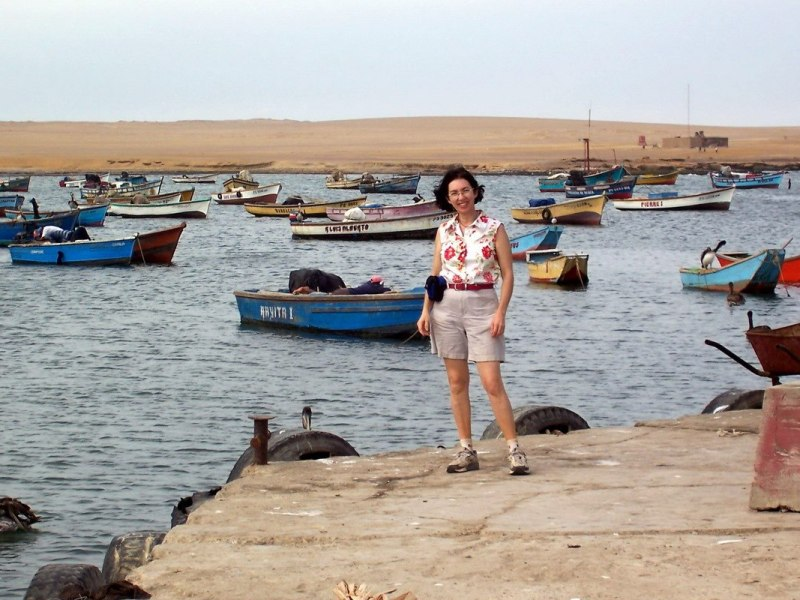 jean stands on Lagunillas wharf - national reserve of paracas - peru