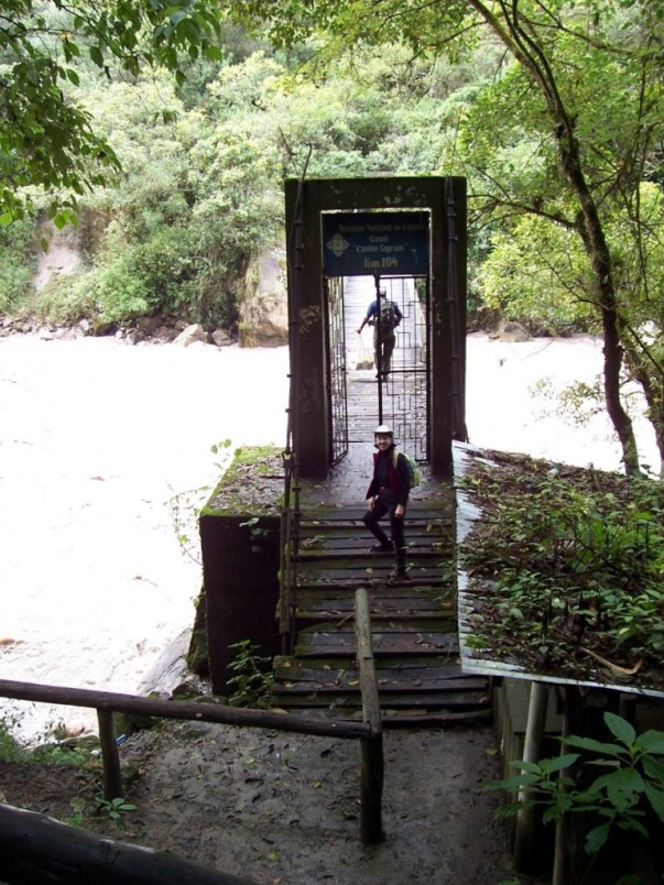 Jean on the steps of the Inca Trail control bridge over the Urubamba River in Peru, South America