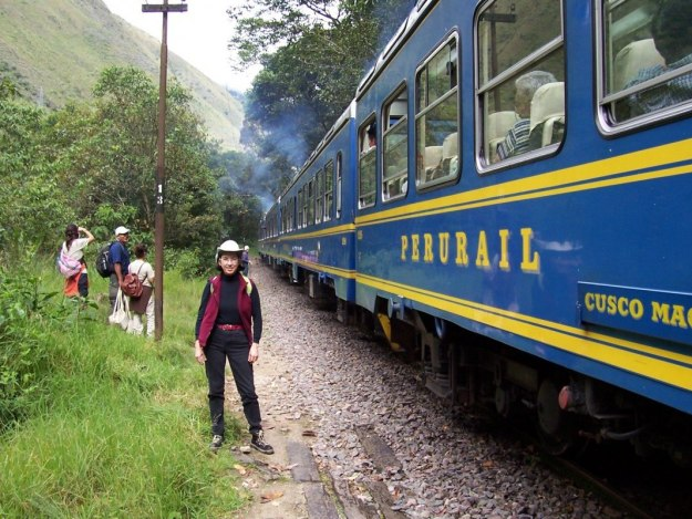 Jean exits PeruRail train at Chachabamba on the Inca Trail in Peru, South America