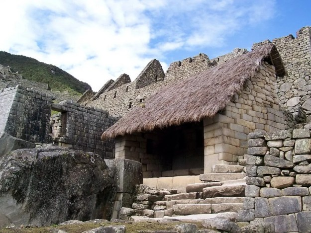 An image of a restored roofed building at Machu Picchu in Urubamba Province, Peru.