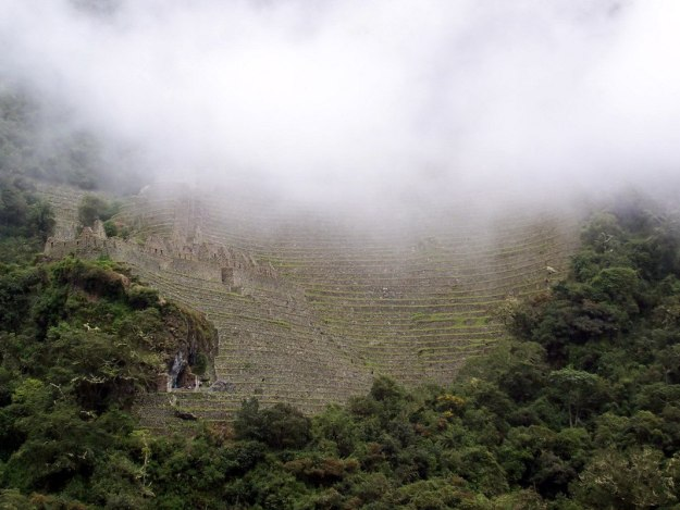 Mist over the terraces at Wiñay Wayna in Peru, South America