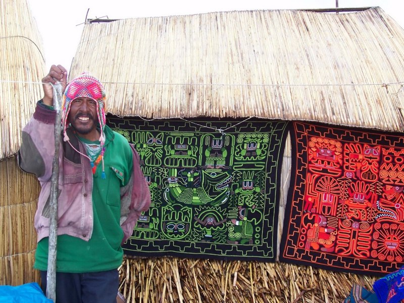 quilt work hanging on wall, floating island, lake titicaca, peru