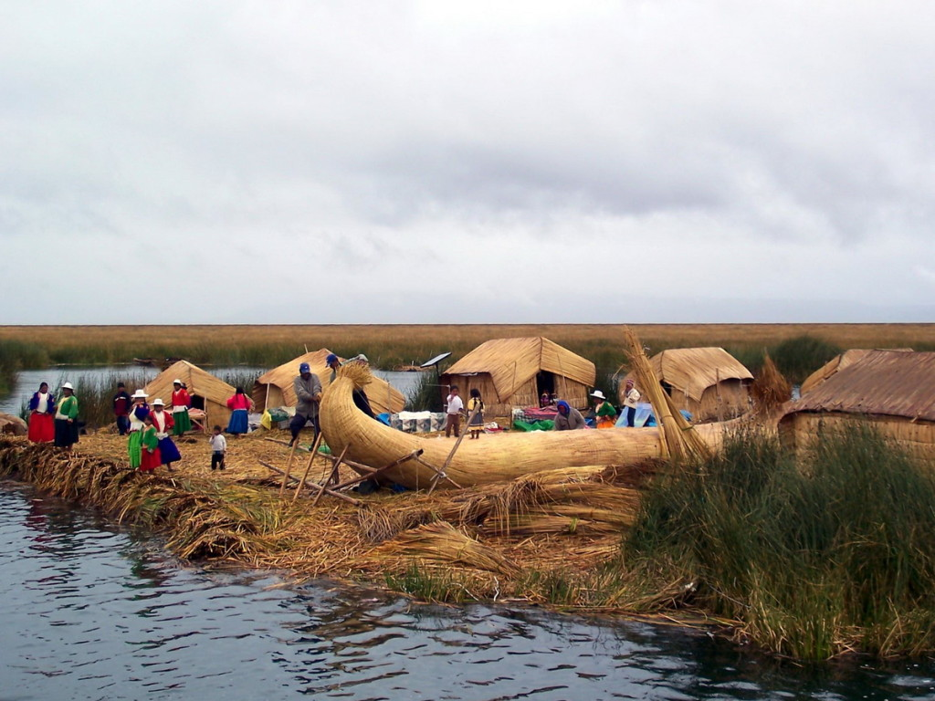 reed boat construction, floating island, lake titicaca, peru