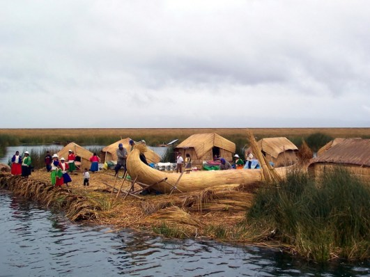 An image of a Uros reed boat under construction on a floating island on Lake Titicaca, Peru.