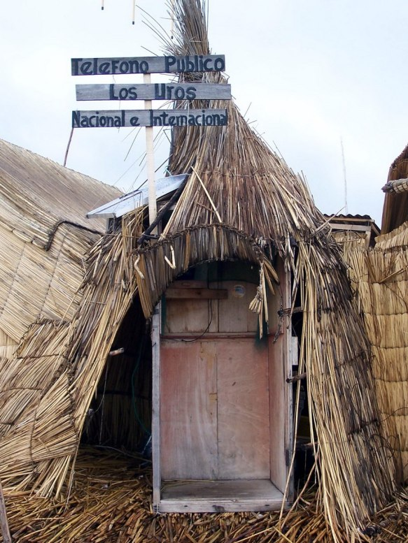 telephone booth on floating island, lake titicaca, peru