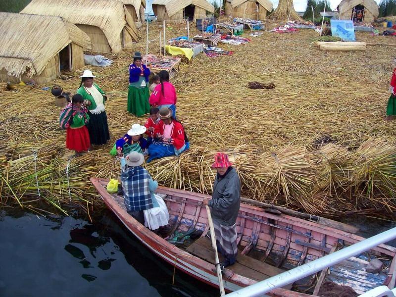 uros women on floating island, lake titicaca, peru
