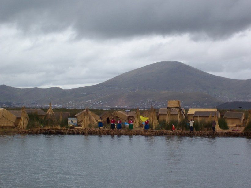 Uros village on a totora reed floating island on Lake Titicaca in Peru, South America