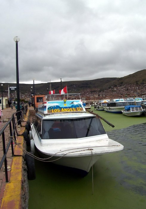 Hired boat at the wharf in Puno harbour on Lake Titicaca, in Peru, South America