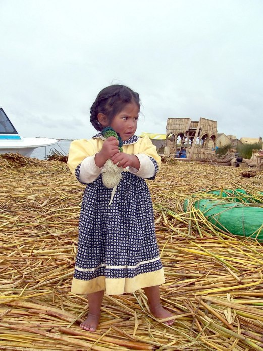 Young Uros girl on a floating island on Lake Titicaca in Peru, South America
