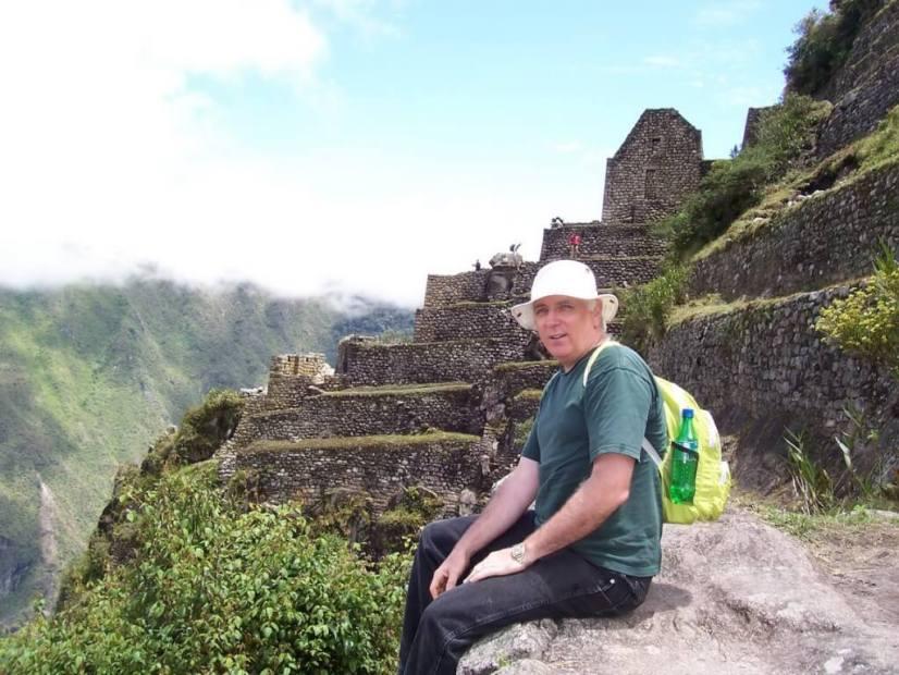 Bob sitting near the top of Huayna Picchu, at Machu Picchu