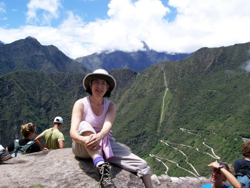 Jean sitting at the top of Huayna Picchu, at Machu Picchu