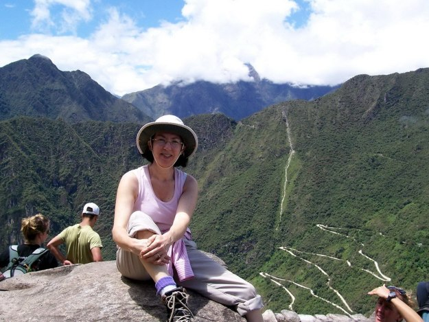Jean sitting at the top of Huayna Picchu, at Machu Picchu