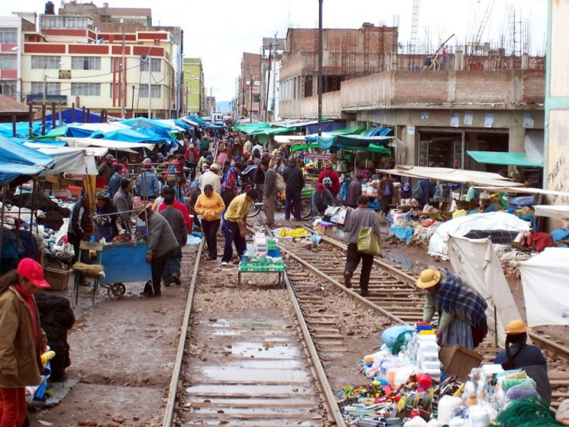 photograph of a street market on the railway tracks in Juliaca, Peru.