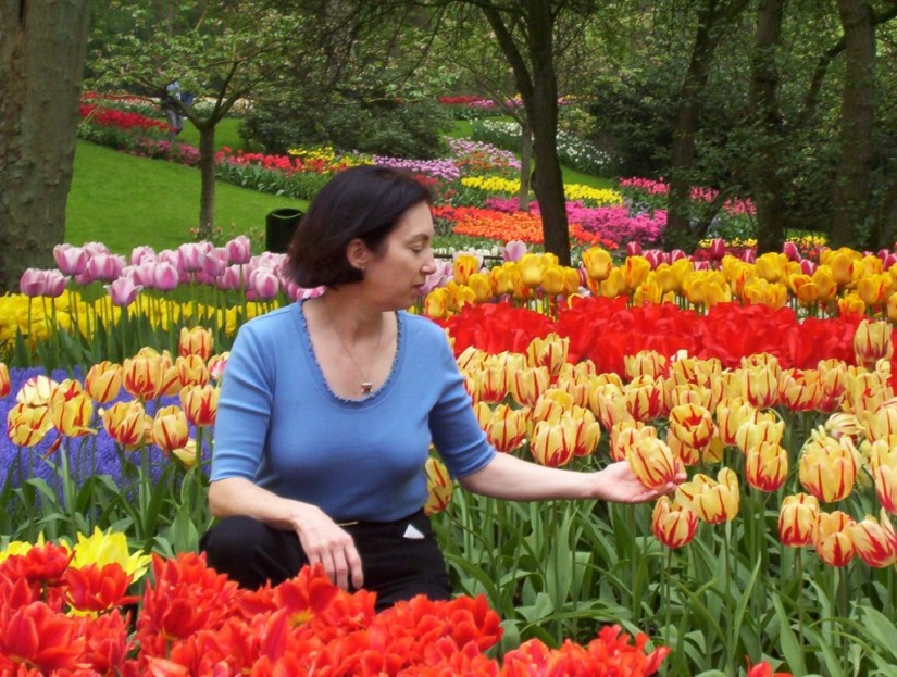 An image of Jean among tulips at Keukenhof Gardens near Lisse, in the Netherlands. Photography by Frame To Frame - Bob and Jean.