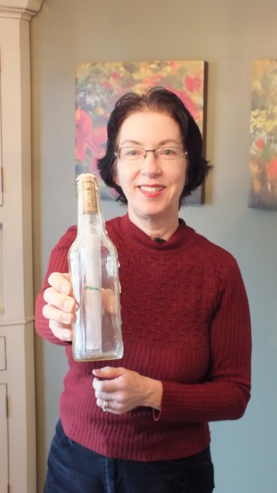 Jean holds the Message in a Bottle