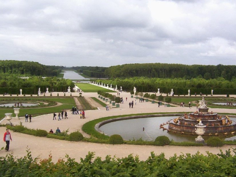 An image of the Latona Fountain and the Grand Canal at the Palace of Versailles in France.