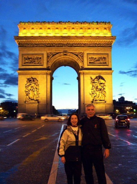 An image of Jean and Bob at Arc de Triomphe at sunset in Paris, France.