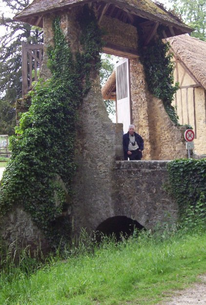 Marie Antoinette's estate gardens - Bob standing at entrance gate - France