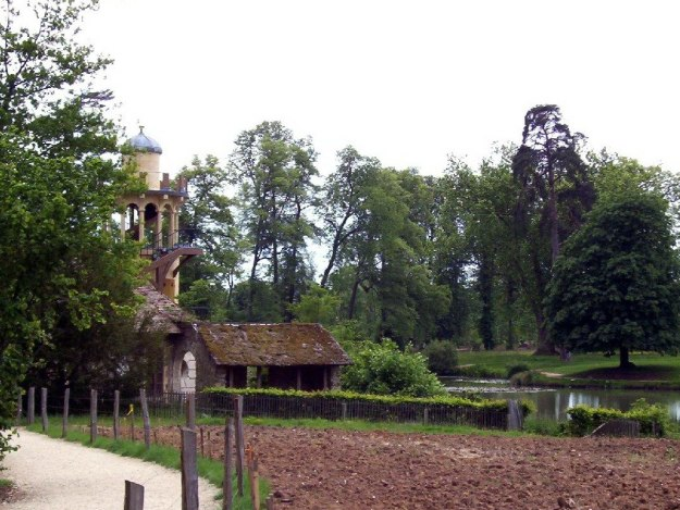 An image of the Marlborough Tower in the Queen's Hamlet at the Palace of Versailles in France.