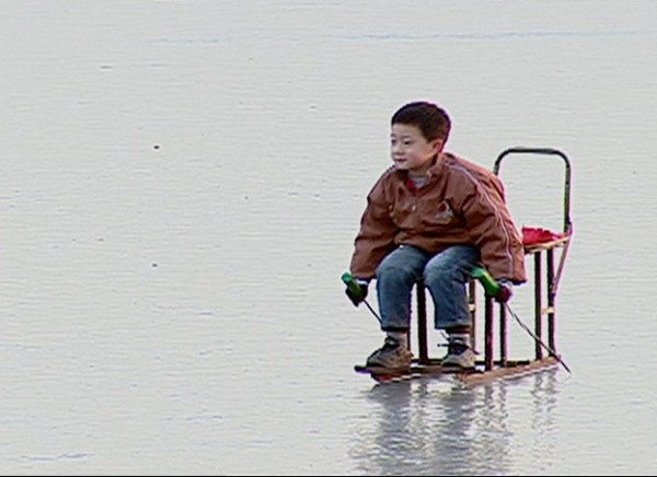 Little boy on sled in Bejing - China