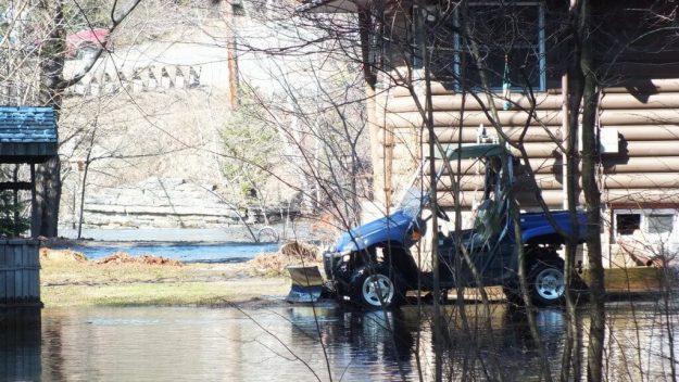 Big East River flood zone - plowing water - Huntsville, Ontario - April 21 2013