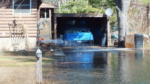 Big East River flood zone - sump pump hard at work - Huntsville, Ontario - April 21 2013