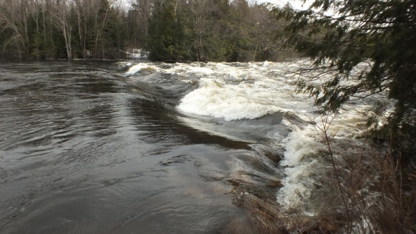 Oxtongue Lake control dam - waters high above dam during major flooding - April 20 2013