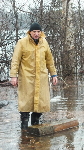 Oxtongue Lake flooding - Bob prepares to move block of wood from flood waters - April 20 2013
