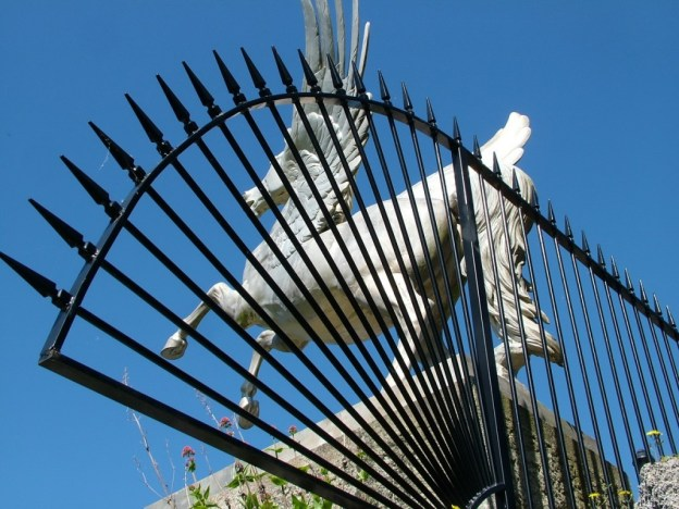 Winged Horse statue through fence - Powerscourt - Ireland